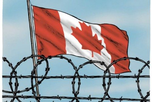 moudakis_canadian_flag_behind_barbed_wire.jpg.size.xxlarge.promo